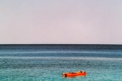 Ikaria adrift - naked in the sun of Seychelles beach