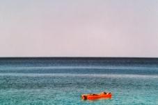 Ikaria adrift - naked in the sun of Seychelles beach