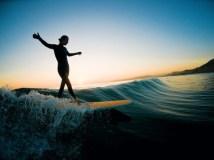 Nana surfs dusk Ikaria